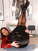 That´s unbelievable - this secretary is all buttoned up in her satin ruffle.. - Granny Girdles